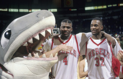 siphotos:  Larry Johnson and Stacey Augmon pose with UNLV's shark mascot after a 1990 game against Loyola Marymount. (Peter Read Miller/SI) SI VAULT: UNLV's Augmon and Johnson are sharpest tandem in the land (11.19.90)