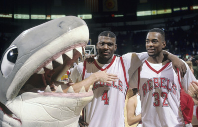 siphotos:  Larry Johnson and Stacey Augmon pose with UNLV's shark mascot after a 1990 game against Loyola Marymount. (Peter Read Miller/SI) SI VAULT: UNLV's Augmon and Johnson are sharpest tandem in the land (11.19.90)  They all looking at me, you such a running rebel, when you in LV - @wale