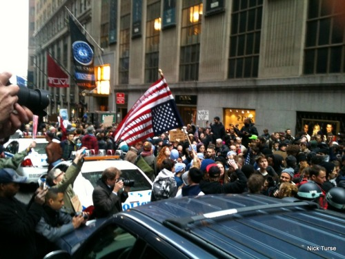 "Occupy Wall Street protesters lock down the intersection of Wall Street and Hanover Street on the November 17, 2011 ""Day of Action."""