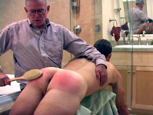 Someone just learned that he is never too old or too big for a bare-ass spanking on Daddy's lap.