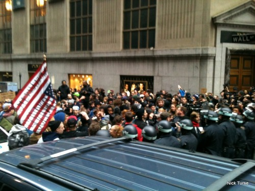 "Another from the same series.  Occupy Wall Street protesters confront NYPD cops at the intersection of Wall Street  and Hanover Street on the November 17, 2011 ""Day of Action."""