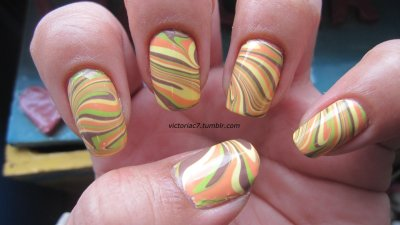Thanksgiving Water Marble When all else fails, water marble! Lol.  At least that's what I do.  Thanksgiving is still a week away, but I these colors felt very Fall/Thanksgiving to me, so I went ahead and marbled with them.   Colors used: OPI - Over The Taupe China Glaze - Lemon Fizz, Peachy Keen Sally Hansen X-treme Wear - Green With Envy