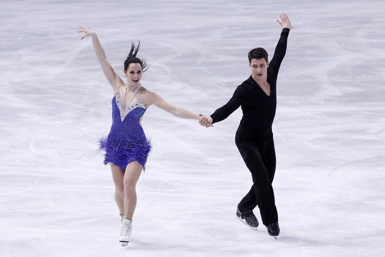 FIGURE SKATING: Tessa Virtue (L) and Scott Moir of Canada perform during the Ice Dance Short Dance in the Bompard Trophy event at Bercy in Paris. Photo: REUTERS/Gonzalo Fuentes