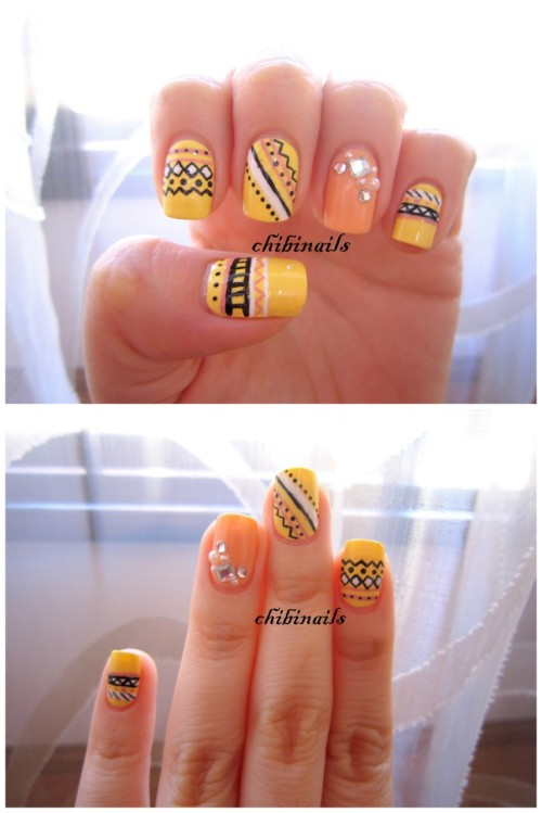Sorry for the hiatus! Finally found some time off to do my nails. Tribal design inspired by Make My Day. They do really awesome tribal designs! <3