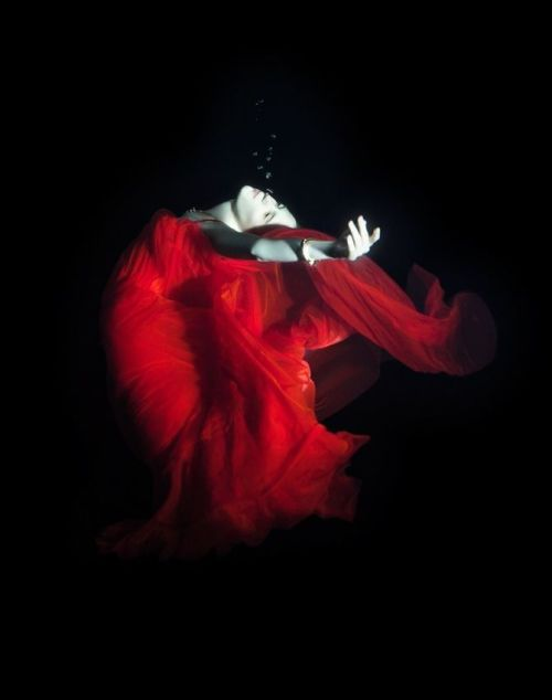 The darkest dance … Crimson flowing … A penitent's blood … Swirling and catching … A most sombre waltz … A song for lost loves … Ears ache to flee … From its clandestine grip … The saddest dance … One for the other … Mimicked perfection … Presented to you … The truest dance … When feet cease their turning … And arms wind together … One last wanton embrace …