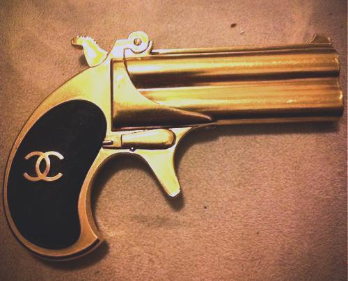 Here Ell, a Chanel gun to go with the LV ones. Dumb idea (I'm probably suggesting this b/c it's 2:44), but we should go as fashion cops next year for Halloween. OR fashion bandits. Something like that. !G OMG brilliant -Ell