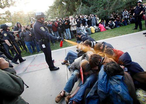 "jp-squared:  UC Davis Campus Police Lieutenant John Pike (530-752-3989 japikeiii@ucdavis.edu) pepper-sprays 30 peacefully sitting demonstrators at point blank range yesterday. ""When students covered their eyes with their clothing, police forced open their mouths and pepper-sprayed down their throats. Several of these students were hospitalized. Others are seriously injured. One of them, forty-five minutes after being pepper-sprayed down his throat, was still coughing up blood."" If you feel so inclined, please call or write Police Lieutenant John Pike and pass this message along.  This is utterly ridiculous. I have no words that explain how much this upsets me."