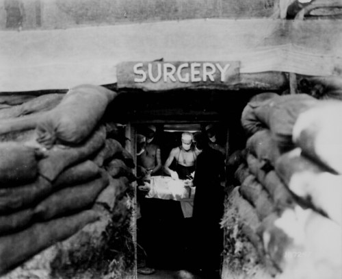 ryanshistoryblog:  Underground surgery room, behind the front lines on Bougainville, an American Army doctor operates on a U.S. soldier wounded by a Japanese sniper - December 13, 1943  From: The National Archives