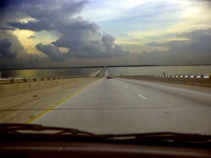 "Toward New Orleans on the Ponchartrain Causeway, July 2004 | selenographie & Amul Kumar ""I carried that fabulous and carnal image of New Orleans with me like a poetic wound for the next two years."" —Andrei Codrescu, from ""Do You Know What It Means to Miss New Orleans?"" as printed in New Orleans, Mon Amour ""I was in a sort of ecstasy, […] Absorbed in the contemplation of sublime beauty … I reached the point where one encounters celestial sensations … Everything spoke so vividly to my soul. Ah, if I could only forget. I had palpitations of the heart, what in Berlin they call 'nerves.' Life was drained from me. I walked with the fear of falling."" —Stendhal (syndrome)"
