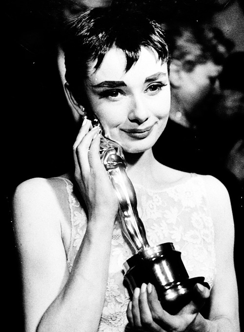 missavagardner:  Audrey Hepburn affectionately to the Academy Award she won for her performance in 'Roman Holiday', photographed by Ralph Morse, 1954.  If she isn't the classiest woman I don't know who is.