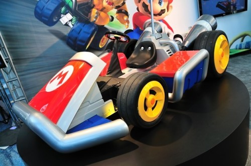 Nintendo has created two life-sized replicas of the Mario Kart cars driven by Nintendo icons  Mario and Luigi, working vehicles that the company debuted at the Los Angeles Auto Show this past week. Built by West Coast Customs, the two karts – identical to those gamers will be able to digitally drive come the December 4 launch of Mario Kart 7 for the Nintendo 3DS – are electric vehicles that can actually be driven around. And some lucky gamers will get the chance to do just that, as Nintendo plans to give away both karts as part of a Gamestop PowerUp Rewards promotion during December.  Video at link.
