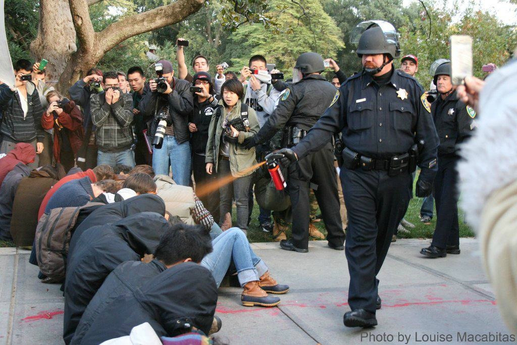 Bag's Take-Away:  Viral UC Davis pepper spray photo. The horror's in the non-chalance. (Cop 1 & Cop 2.)    (photo: Louise Macabitas) ————— Topping LIFE.com's 2011 list of Best Photo Blogs, follow us at: BagNewsNotes; BAG Twitter; BAG Facebook; Bag by Email.