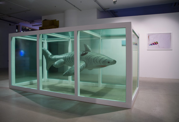 """Dave Murray, Seapig (installation view: left), mixed media and inflatable shark, 10' x 10' x 4.5"""", 2009"""