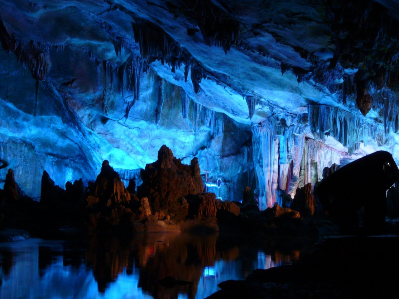 quantumaniac:  Reed Flute Cave The famous Reed Flute Cave is a landmark and tourist attraction in Guilin, Guangxi, China. The cave itself is over 180 million years old. It is a natural limestone cave with multicolored lighting and has been one of Guilin's most interesting attractions for over 1200 years. The cave got its name from the type of reed growing outside, which can be made into melodious flutes. Reed Flute Cave is filled with a large number of stalactites, stalagmites and rock formations in weird and wonderful shapes. Inside, there are more than 70 inscriptions written in ink, which can be dated back as far as 792 AD in the Tang Dynasty.