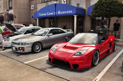 Henry's Sorcery wide body NSX sitting pretty next to a clean and simple R33 Skyline.