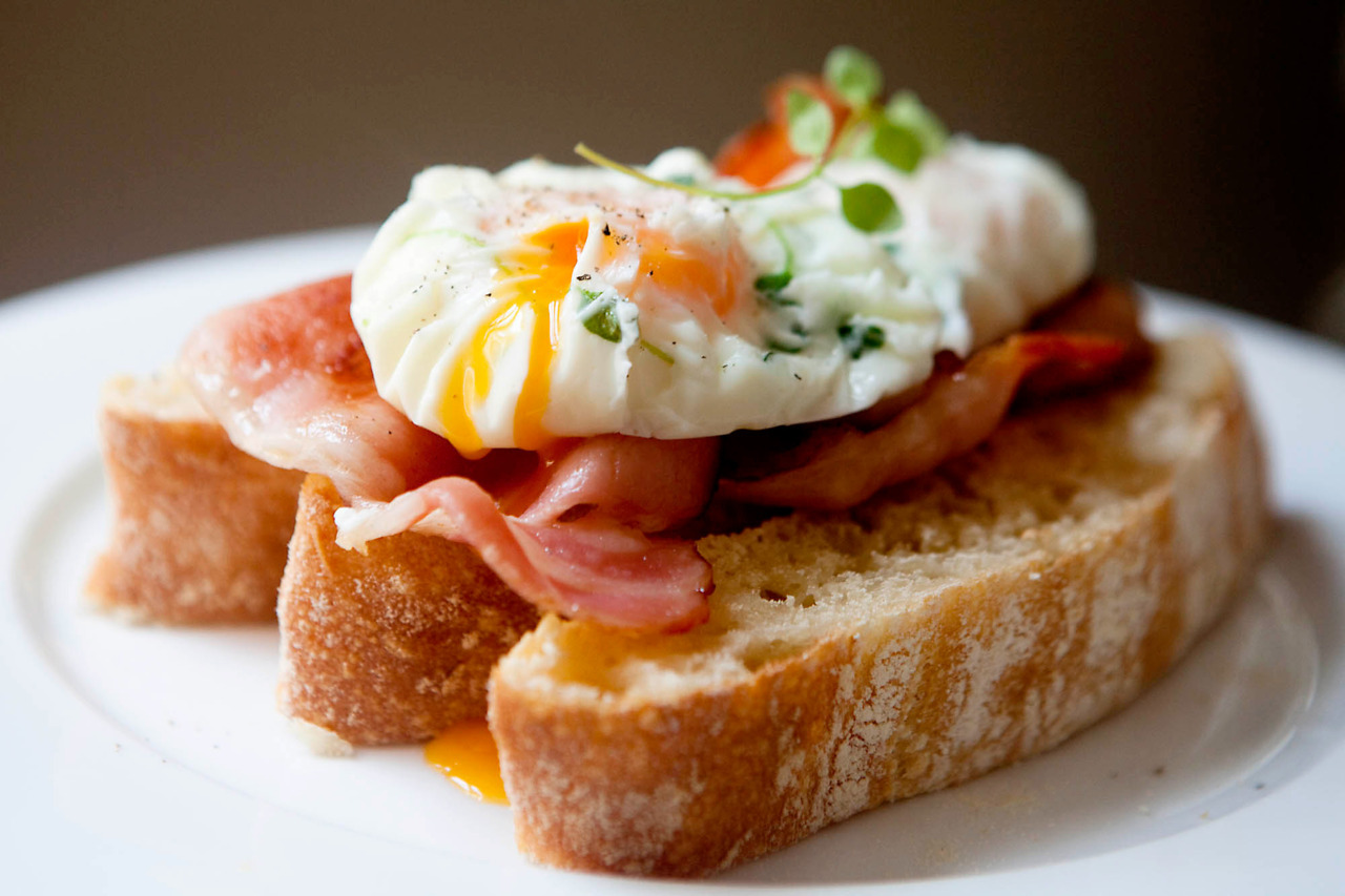 Thyme Poached Eggs with Bacon and Ciabatta I found this excellent recipe for ciabatta bread (I made it into a loaf instead of pizza), the only change is that I added another half cup of flour or so since it was too watery and didn't look like the photos.  Great recipe, very soft fluffy bread and it only took a couple hours to make and it very simple on a Sunday morning. For the eggs, I poached them in cellophane (using a bowl, crack an egg into the center of the cellophane, add a sprig of thyme, and scrunch up the top).  Boil for about 3-5 minutes until the whites are cooked.  Serve with fresh slices of ciabatta and bacon.