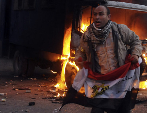 "thepoliticalnotebook:  Back to Tahrir. Protesters returned to the streets ahead of parliamentary elections and the ensuing violence is now in its second day. Police doused the crowds with tear gas, rubber bullets, and ""birdshot"" pellet cartridges and clashes erupted with protesters, including mutual stone-throwing. Two are dead and more than 600 have been injured so far. Ursula Lindsey over at The Arabist writes:  These clashes feel almost unavoidable, given the military council's terrible performance, the increasing vocal criticism it is facing, the rising tensions of all kinds surrounding the upcoming (poorly planned, utterly confusing) elections — given the terribly unclear transition process that has been put in place, and the fact that none of the revolution's demands, including the reform of the security forces and real transitional justice, have been met.  Indeed, the transition has been going very poorly, with the Supreme Council of Armed Forces and the people increasingly at odds over lack of progress and the apparent moves of SCAF to gain political power.  Above: A protester with the Egyptian flag. Photo Credit: Reuters. [Via.]  Al Jazeera now reporting at least 11 dead in Tahrir today. To hell with SCAF and all cops and armies! Victory to the Egyptian revolution!"