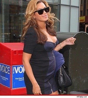 Beyonce, pregnant and still beautiful.  Love her.
