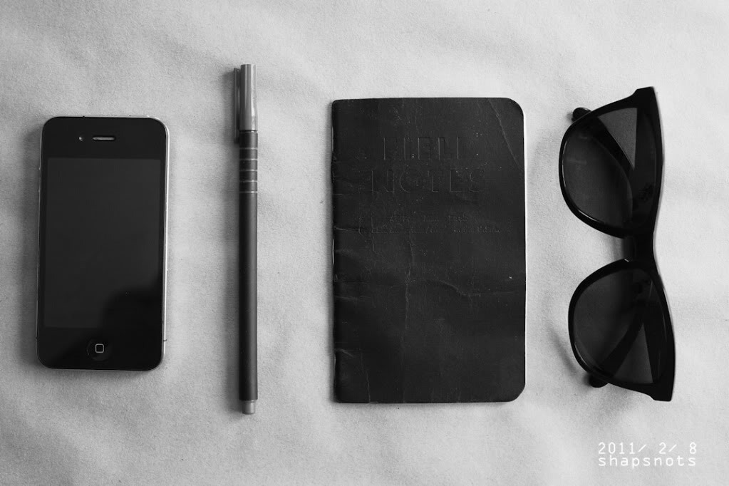 Less is more when it comes to packing for the sunshine. Phone, pen, notebook, sunglasses - check!