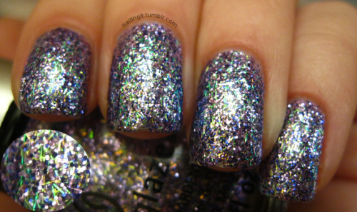 "china glaze - marry a millionare  the party on my nails right now is OUT, OF, CONTROL! in marry a millionaire, we've got a couple different shades of purple glitter in addition to bar glitter that shifts between green, blue and gold! i like the bar glitter in this one because it's small, not overbearingly ""hairy."" truly, truly, awesome polish! (fyi, i think this was about 3-4 coats. slight word of warning there.)"