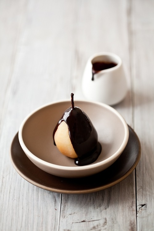 spiced poached pears with warm chocolate sauce and vanilla ice cream