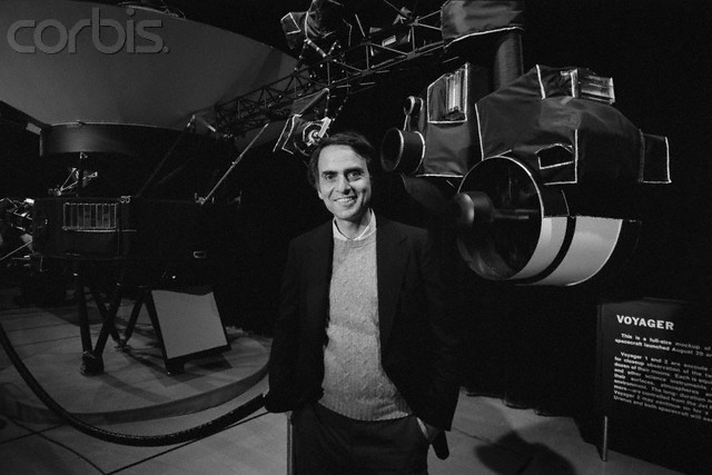 1981 - Carl poses with a model of the Voyager Spacecraft