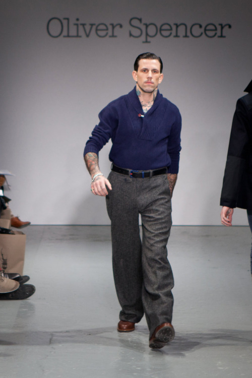"doryane:  Oliver Spencer FW 11  Until now, the term ""baggy nut-huggers"" seemed like an oxymoron.  But when you jack a pair of trousers that are six inches too long and four inches too wide up to your nipples, I guess anything is possible.  Thank you, Oliver Spencer, for reminding us that a Neanderthal with his sweater tucked into his baggy nut-huggers is still a Neanderthal."