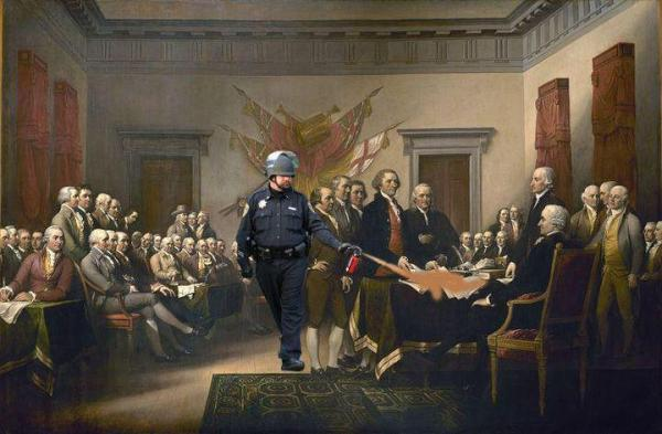 Lt. John Pike pepper spraying the Bill of Rights.