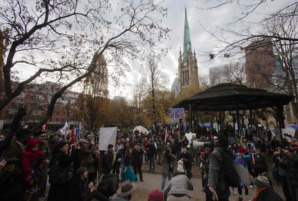 "Occupy Toronto: Protesters must vacate park, judge rulesOccupy Toronto protesters must pack up their tents and leave St.  James Park, where they have been camping out for more than a month, a  Superior Court judge has ruled. In a decision released Monday, Justice David Brown found the city was  within its rights to force an end to the demonstration, calling it a  ""reasonable limit"" on the group's rights under the Canadian Charter of  Rights and Freedoms. ""If the protesters possess a constitutional right to occupy the park  and appropriate it to their use, then the next protest group espousing a  political message would have the right to so occupy another park, say,  Moss Park; and the next group the next park, and so on, and so forth,""  Judge Brown wrote in his 54-page ruling. ""So would result a 'tragedy of  the commons,' another ironic consequence of a movement advocating  greater popular empowerment."" (Photo: Mark Blinch/Reuters)"