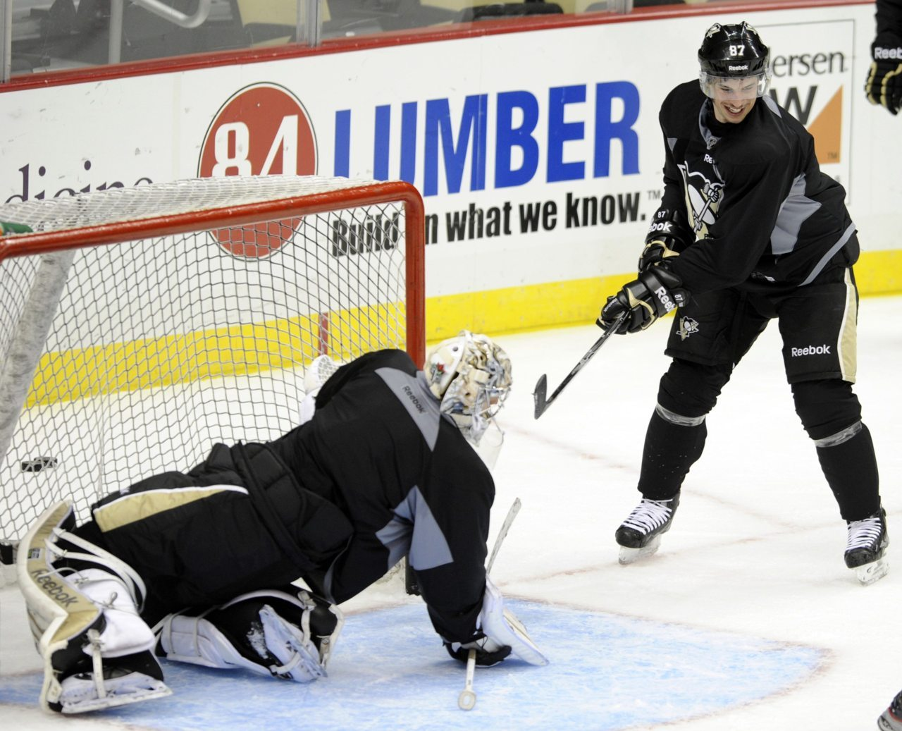 "nationalpostsports:  He's baaaack…Pittsburgh's Sidney Crosby shoots on teammate Marc-Andre Fleury during the ""morning skate"" in preparation for Crosby's return to action Monday night against the New York Islanders. Photo: David DeNoma"