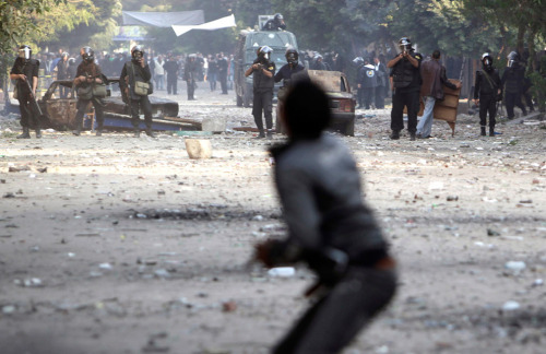 Meanwhile.. in Cairo.. Summary from The Guardian:  - Thirty-three people are reported to have been killed in the violence over the past three days according to morgue officials. The ministry of health said more than 1,500 have been injured in the latest clashes in and around Tahrir Square - the worst bout of violence in Egypt since the revolution that ousted Hosni Mubarak. Witnesses said protesters had been hit by rubber bullets and suffocated with aggressive tear gas. (See 1.03pm.) Video has been circulating of police apparently beating protesters, including some lying on the ground. The International Federation for Human Rights accused the policemen of using live ammunition on protesters. (See 2.04pm.) Reports indicated that demonstrators were responding by hurling stones and molotov cocktails. - Crowds in Tahrir Square have been growing and clashes continuing as night has fallen in the Egyptian capital. Riot police are continuing to fire teargas and casualties continue to be taken to the field hospital. Chants have called for the trial or execution of Scaf head Field Marshal Mohamed Hussein Tantawi.   More at the Guardian  Photo: Asmaa Waguih/Reuters