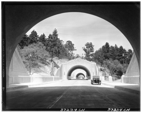 The Figueroa Street Tunnels in the 1930s. As Eric Richardson writes today for blogdowntown, the first three tunnels—now part of the Arroyo Seco Parkway (CA-110)—were dedicated on this day in 1931. A fourth tunnel and a viaduct extending Figueroa over the Los Angeles River would come later.