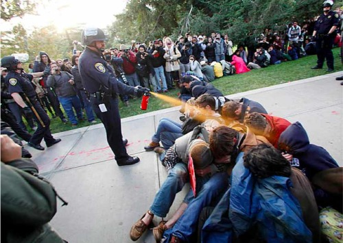 "millionsmillions:  This week, UC Davis students protesting a tuition increase (among other things) were mercilessly pepper sprayed by their own campus police. In response, Nathan Brown, a non-tenured associate professor of English, has spoken out and called for UC Davis chancellor Linda Katehi's resignation. In solidarity with Brown's demand, students silently gathered around Katehi's office as she exited. For those hoping for further illumination on the entire fiasco, I recommend this list of ""Ten Things You Should Know About Friday's UC Davis Police Violence."" Elsewhere within the UC system, former U.S. Poet Laureate Robert Hass details his harrowing experience at the UC Berkeley protests. [Image source]  I like how the women in charge of the campus said that the protesters had trapped the police…"