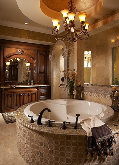 Love this classic and elegant traditional bathroom, with the round Jacuzzi tub encased in granite and tile. (via Beautiful Bathrooms / wishful thinking..)