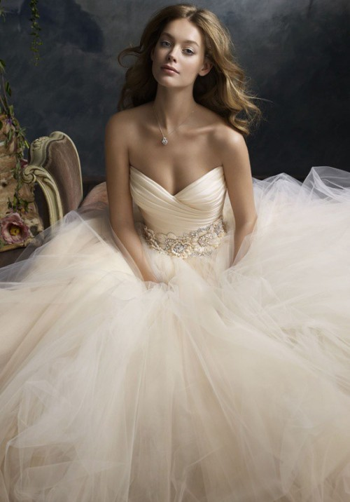 Strapless wedding gown in a very soft and delicate blush hue, with a beaded sash and layered skirt with tons of filmy tulle (via Gorgeous Wedding Things / Blush - AMAZING!)