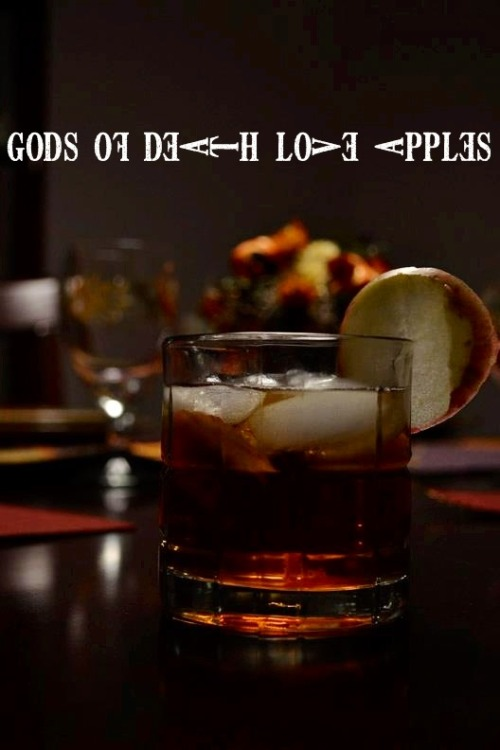 Gods of Death Love Apples (Death Note Cocktail) Ingredients:1 oz. brandy1 oz. dark rum (preferably Coruba. Myers's Dark Rum works as well)1 dash of angostura bitters 4 oz. apple juice 1 apple  Directions: Mix the brandy, rum, and bitters in a separate glass.  Crush a little bit of apple in a rocks glass to add a bit of flavor.  Add the alcohol, apple juice, and ice.  Serve with an apple garnish. Drink created and photographed by Eddie Strickland. Thanks for the submission!