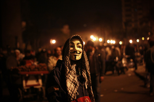 Guy Fawkes hits Tahrir Square, keffiyeh and all. {We've collected some photos from the protests in Egypt's Tahrir Square. This one's by Mosa'aberising]