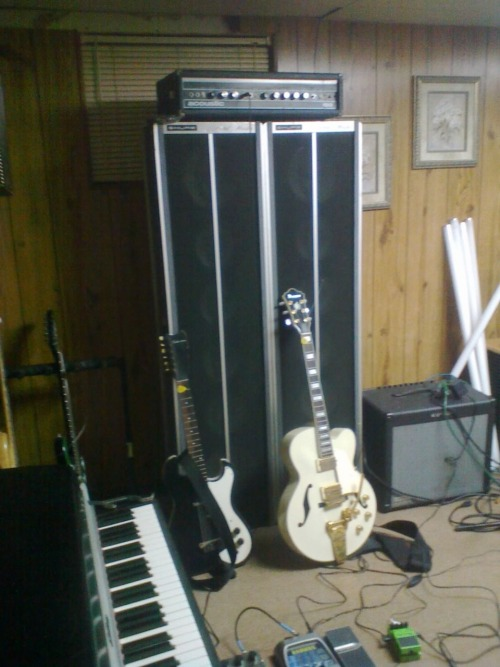 Danelectro DC-59, Ibanez Artcore and HOLY MOTHER LOVE BONE, WOULD YOU LOOK AT THAT AMP! Now HERE'S a practice space. Tuggyt says that his school were getting ready to throw these PA Cabs away, so he (generously) said he would take them off their hands for free. He had to buy an old Acoustic amp head to go on top, but thats still a pretty sweet deal. Send your guitars to www.guitarporn.co.uk/submit Like us at www.facebook.com/guitarporn Follow us at www.twitter.com/guitarporn