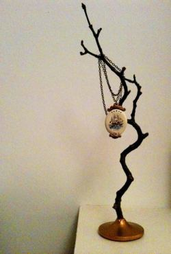 Ship pendant necklace, fallen twig jewellery stand.