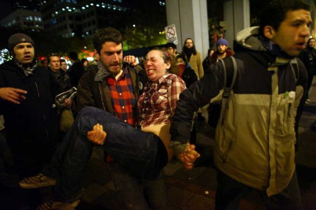 thatawkwardtumblr:  This Is Jennifer Fox, A Protester At Occupy Seattle, Who Was Pepper Sprayed And Kicked In The Stomach While Trying To Remove Herself From A Crowd Of Protesters And Police Officers. She Was Also Three Months Pregnant. She Had A Miscarriage Today Due To Police Brutality.  Be Against Occupy Wall Street All You Want, But Don't Sit There And Tell Me That This Is Right.