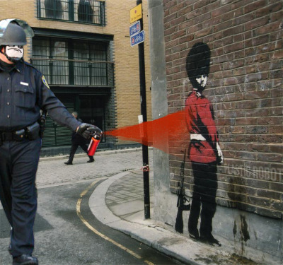 Casually Pepper Spray Banksy's Guard, by Plastic Robot