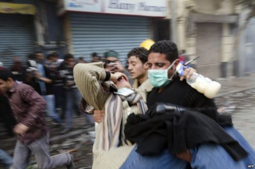 "A protester is carried away during clashes with security forces Tahrir Square in Cairo on November 21. Thousands of Egyptians are converging on Cairo's Tahrir Square in response to a call by activists for a ""million-man march"" after an offer by the civilian cabinet to resign failed to quell unrest…[READ MORE]"