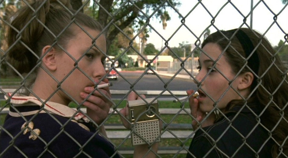 lostinscarlett:  Scarlett and Emmy Rossum in 'An American Rhapsody' (2001).