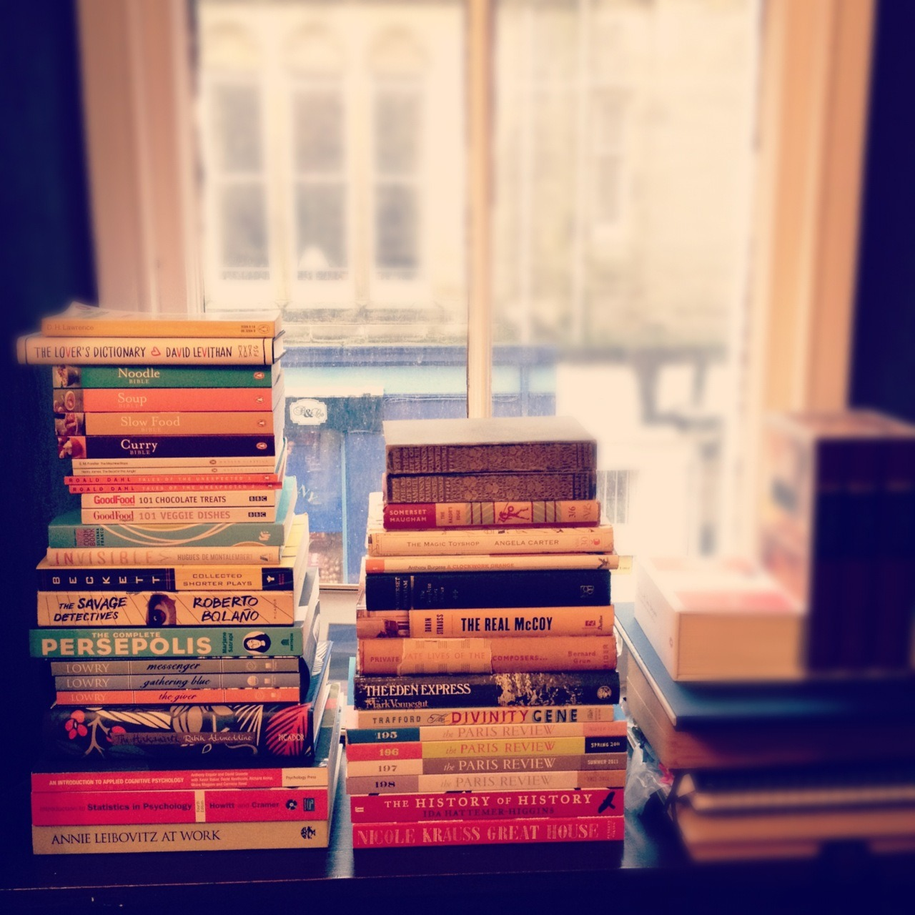 distantheartbeats:  More book piles! When I first moved into this flat I was excited about the window seats (seat is a generous term, they're not deep), and I imagined I'd perch on the edge and read. Alas! my books needed space, and they took it over.