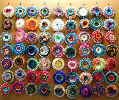 truebluemeandyou:  DIY CD Weaving. Scrap Yarn and if 1-6th graders can do this, so can I! I have literally hundreds of DVDs that didn't render correctly and now I know what I can use them for. Photos and story here at Make it a Wonderful Life, tutorial from the same here. EDIT: UPDATED MORE DETAILED TUTORIAL HERE.