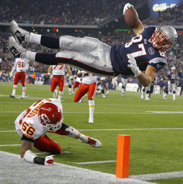 Patriots tight end Rob Gronkowski leaps and scores a touchdown over Chiefs linebacker Derrick Johnson in the second half of Monday's game. New England broke the game open in the second half and coasted to a 34-3 victory. (REUTERS/Brian Snyder) HACK: Patriots take command of the AFC EastVIDEO: Jets have key questions to answer