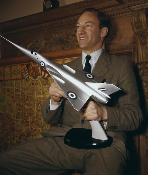 """Aviator Peter Twiss pictured with the model of the Fairey Delta 2 'Droop Snoot', circa 1956. Twiss piloted the plane which was the first to exceed 1,000 miles per hour in March 1956. (Photo by Hulton Archive/Getty Images)"""