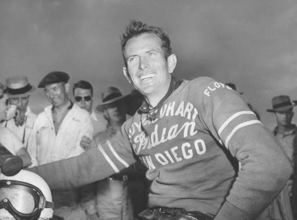 Floyd Emde models a great Indian motorcycle racing jersey after winning the 200 mile race at Daytona Beach Motorcycle races. (1948)