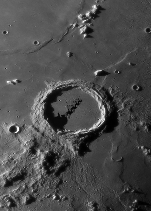 Huh? Normally the crater Archimedes shows a smooth volcanic floor, small pockmarks of more recent craterlets and shadows from the craggy wall that surrounds it. So what is this? A transient lunar phenomenon? Or the stuff that dreams are made of? Hmmmm.