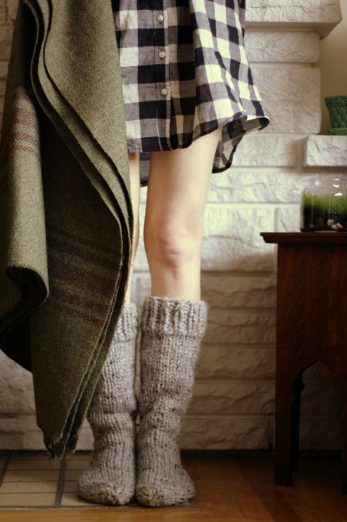Comfy socks and large flannel shirts. I want to be snuggled up in them now reading a book and having tea looking at it snow outside. That is my dream right now.